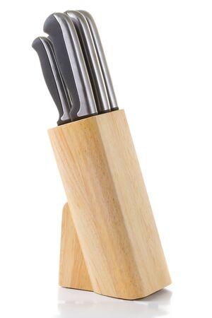 Set of kitchen knifes on white background photo