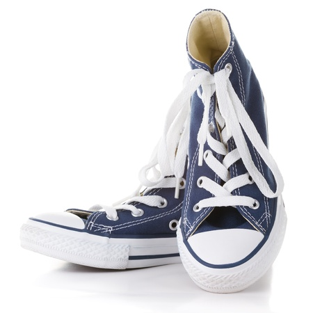 New  blue sneakers on white background photo