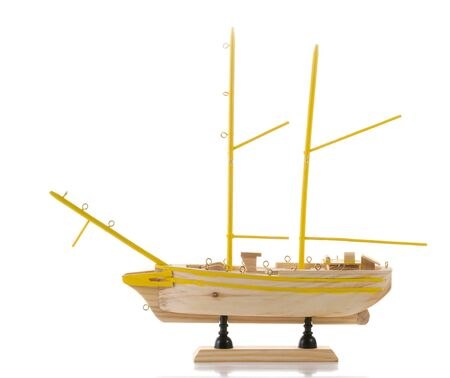 Unfinished model of ship without sails isolated on white photo