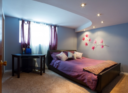 Bedroom with furnishing in a new house. Banco de Imagens