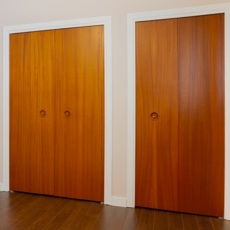 Wooden doors of the closets in the bedroom photo