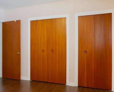 Wooden doors of the closets in the bedroom