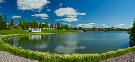 non urban: Beautiful pond with estate homes in the background in Winnipeg  Canada
