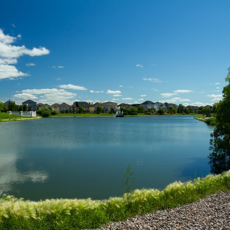 rural development: Beautiful pond with estate homes in the background in Winnipeg  Canada