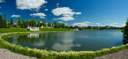 landscaped: Beautiful pond with estate homes in the background in Winnipeg  Canada
