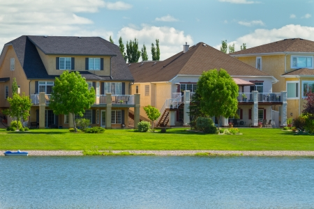 rural community: Canadian luxury houses by pond in a new development of Winnipeg