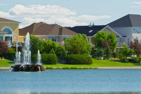 lake winnipeg: Canadian luxury houses by pond in a new development of Winnipeg