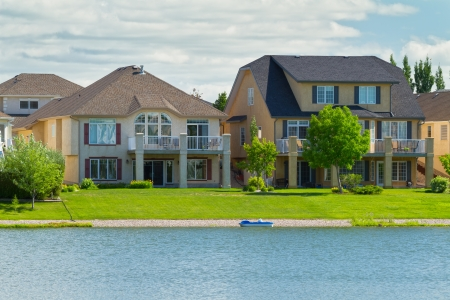 Canadian luxury houses by pond in a new development of Winnipeg