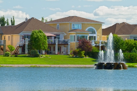 Canadian luxury houses by pond in a new development of Winnipeg photo