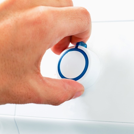 Hand Turning Washing Machine Appliance Dial