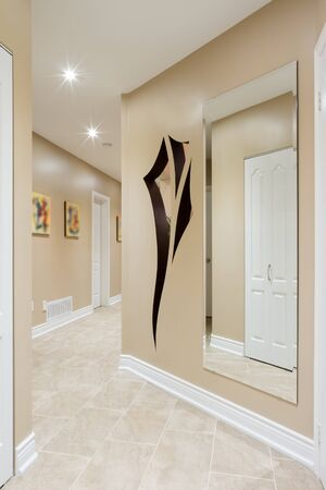 Hallway interior in a new house  with art design on the wall photo