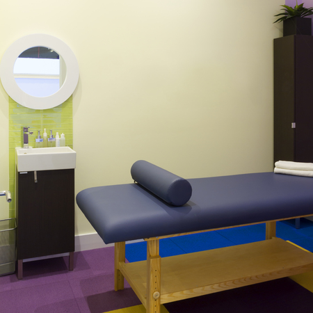 massage table: Interior  of massage room in a clinic center
