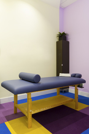 Interior  of massage room in a clinic center photo