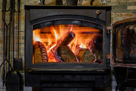 stone fireplace: Old fireplace with a burning firewoods Stock Photo