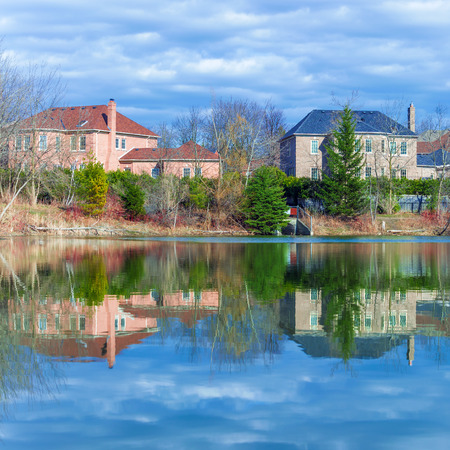 canada country: Country houses on rhe pond in Canada