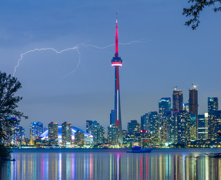 building cn tower: Toronto Downtown Skyline at night with lightning