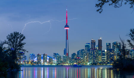 Toronto Downtown Skyline at night with lightning photo