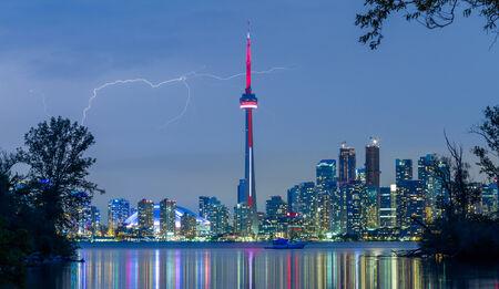 Toronto Downtown Skyline at night with lightning photo