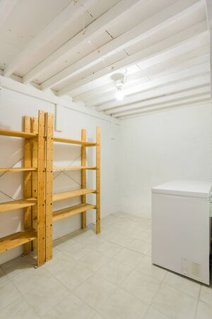 home appliances: Old cellar or cold room in the basement