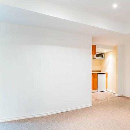 basement: Empty basement living room with kitchen design