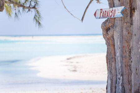 Sign on the paradisaic beach photo