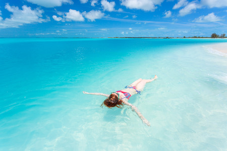 Woman floating on a back in the beautiful sea Stock Photo