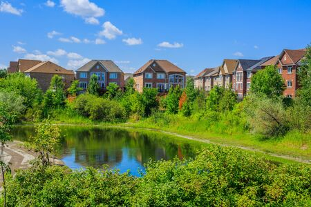 new development: Canadian luxury houses by pond in a new development of Toronto Stock Photo