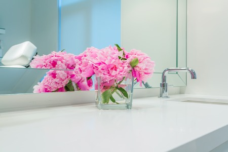 on mirrors: Interior design of a luxury bathroom and flower decoration