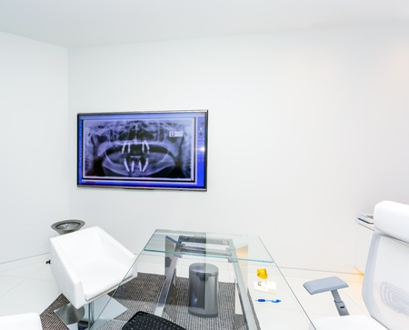 computer room: A Modern Dental Office with fluorography on tv screen