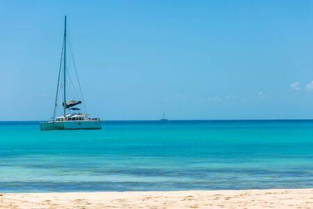 sailing boats: Catamaran at the tropical beach of Cuba Stock Photo