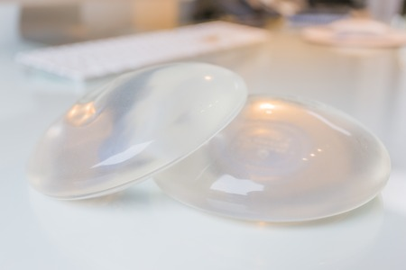 Beautiful breasts: Two silicone breast implant in doctor office Kho ảnh