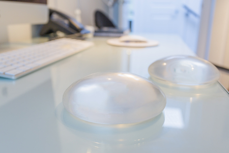 Two silicone breast implant in doctor office Foto de archivo