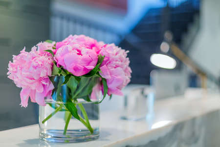 Interiors of a office medical reception with beautiful pink flowers in vase Stock Photo