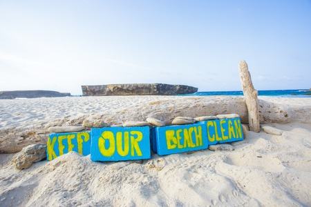 Keep our beach clean. Call to action in Aruba beach Banco de Imagens - 66443368
