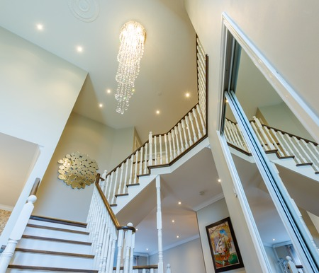 Beautiful foyer looking down hardwood stairs in new house Stock Photo