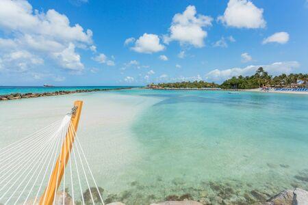 aruba: Empty hammock on tropical beach in flamingo island. Aruba Stock Photo