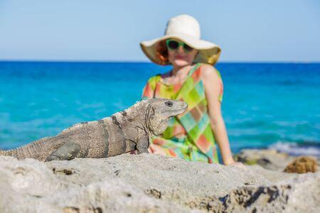 Women and iguana