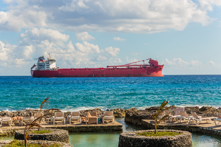 argo freight ship in the caribbean sea. Freight Transportation. Stock Photo
