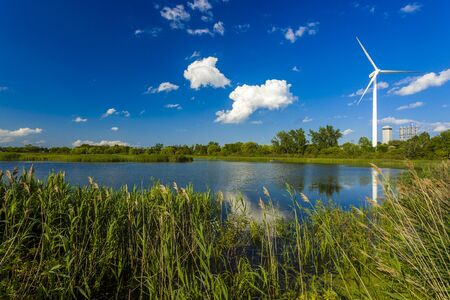 Wind power generating stations in the park Stock Photo
