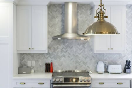 Modern white kitchen clean interior design with hardwood stairs on background