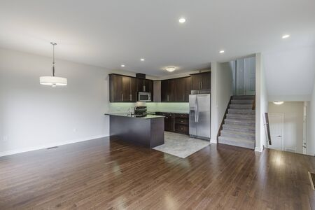 Interior design of modern kitchen and Living room in a new house