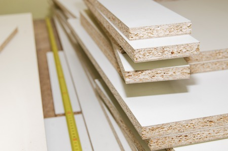 Details carpenter for furniture, MDF close-up of the background