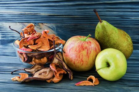 variation: still life of fruit and dried fruits on wooden background