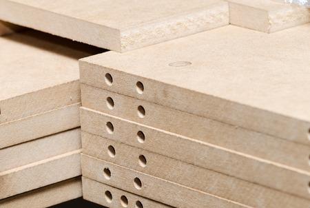 Details carpenter for furniture, MDF close-up
