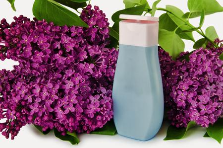 bath supplement: Plastic shampoo bottle on a lilac background Stock Photo