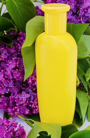 bath supplement: Plastic shampoo bottle on a lilac background Stock Photo