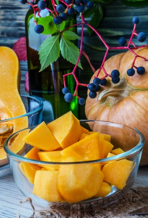 Pumpkin and pumpkin jam, puree or sauce on green with white tablecloth. Autumn still life. Stock Photo