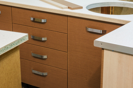 Master sets in a kitchen cupboard with drawers tray spoons and forks