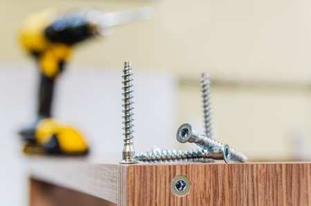 the process of furniture assembly screws closeup Stock Photo