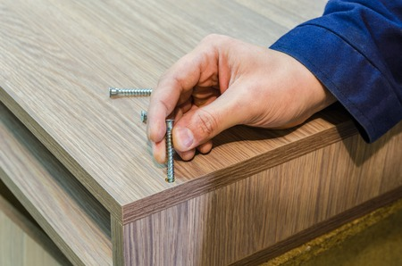 the process of furniture assembly screws closeup Stock Photo